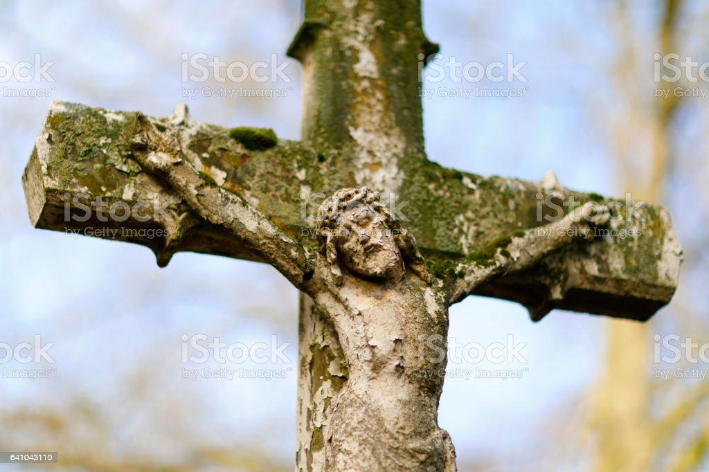 Weathered Jesus sculpture on Melaten Graveyard stock photo