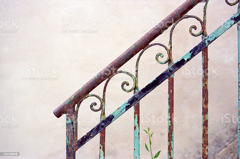 Weathered metal handrail with copyspace on wall stock photo