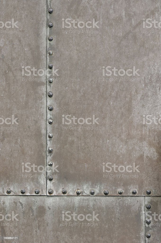 Weathered metal surface with rivets stock photo