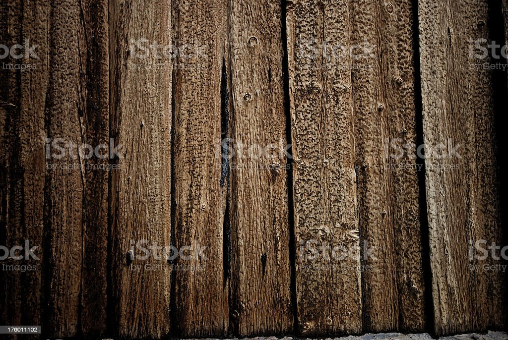 Weathered old wooden planks with tar royalty-free stock photo