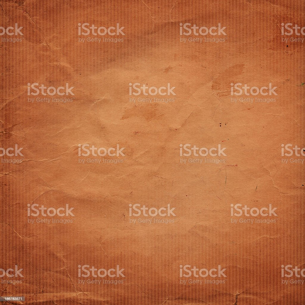 weathered orange paper with vignette stock photo