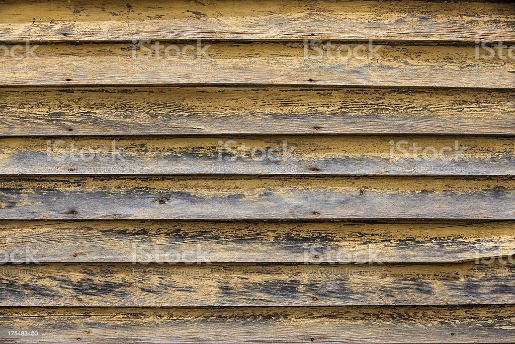 weathered peeling yellow planks background royalty-free stock photo