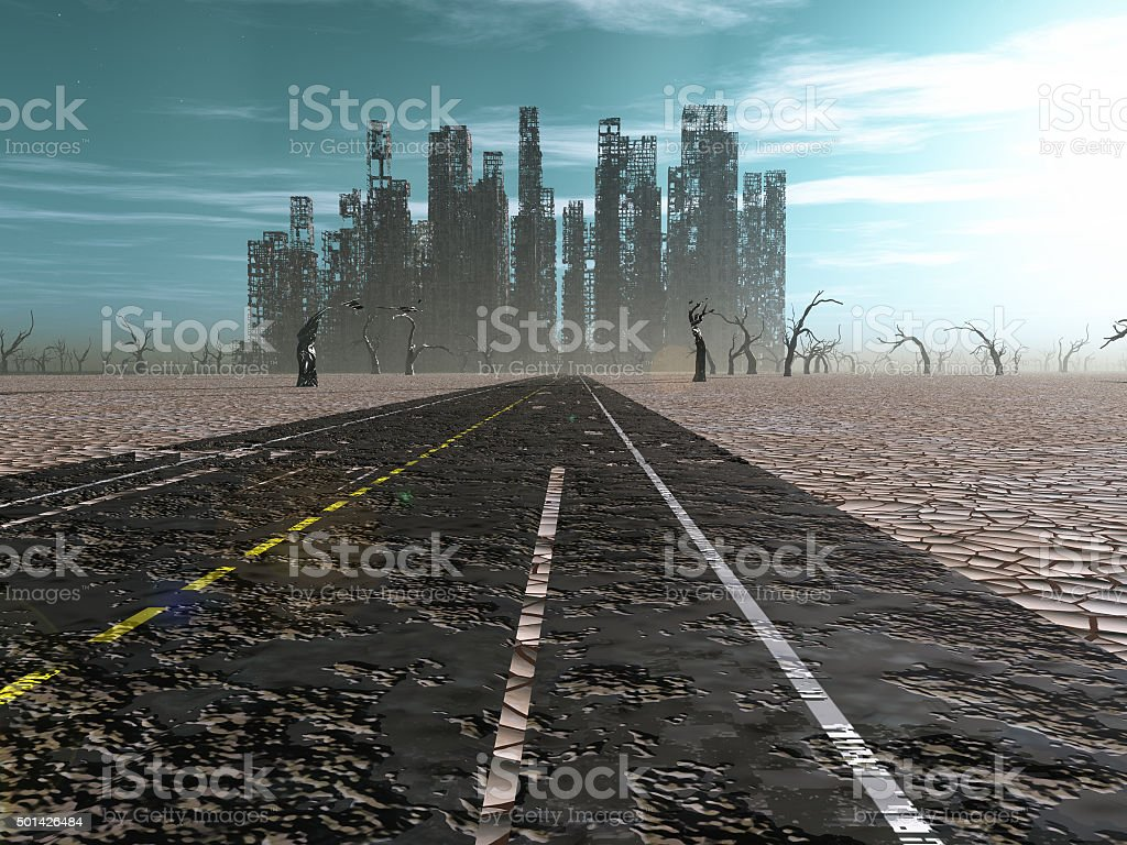Weathered road leads into abandoned city stock photo