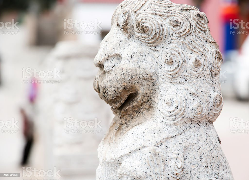weathered rock lion, the ancient in Kumbum Monastery stock photo