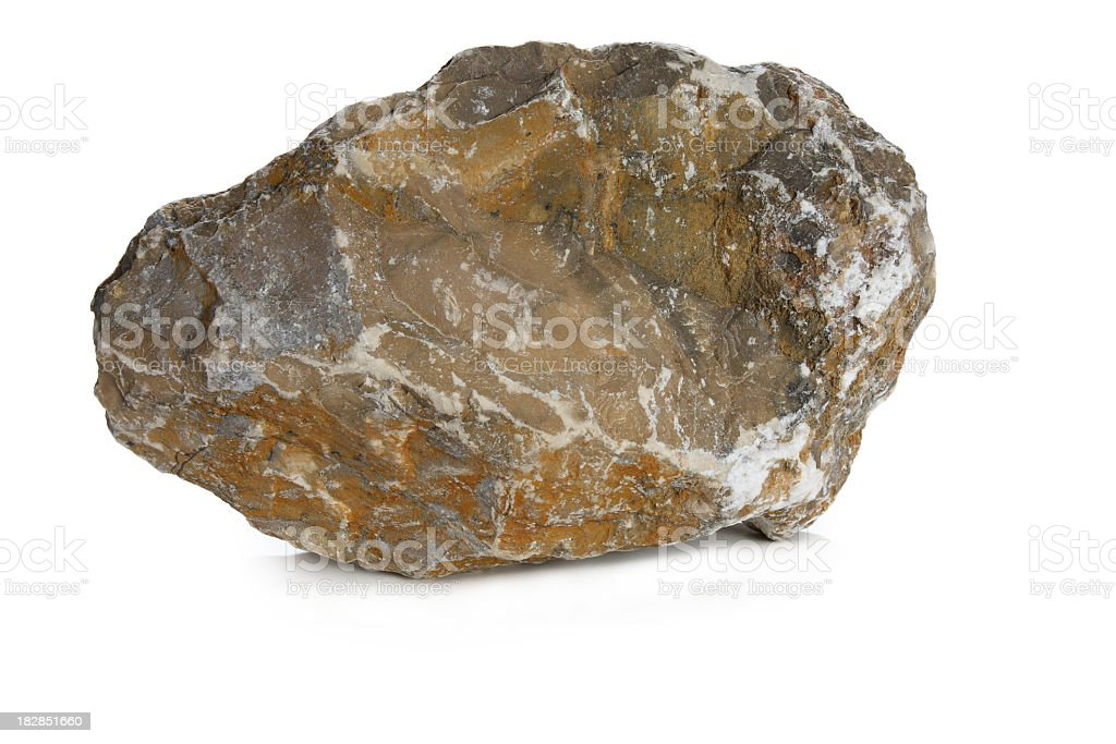 A weathered rock on a white background stock photo