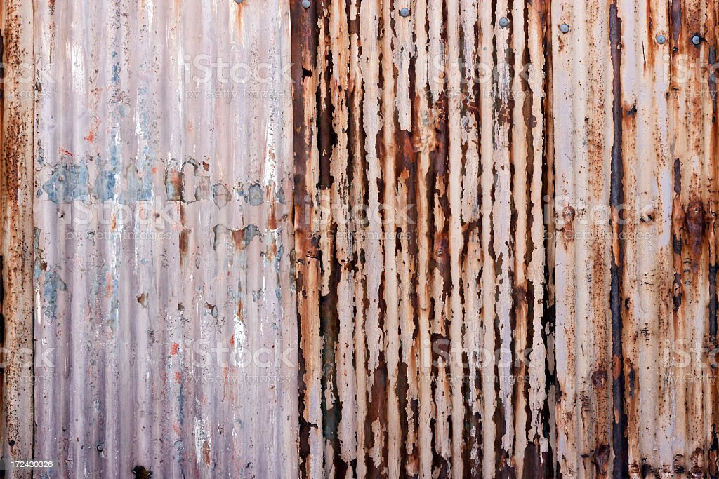 Weathered rusty corrugated iron wall background with copy space royalty-free stock photo
