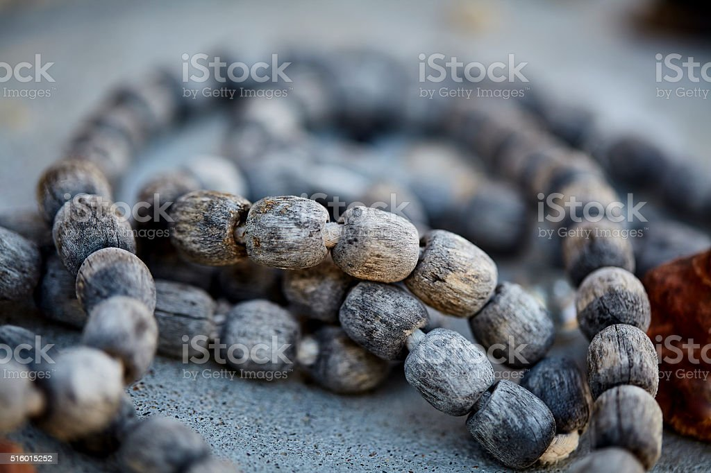 weathered sacred wood prayer beads closeup stock photo