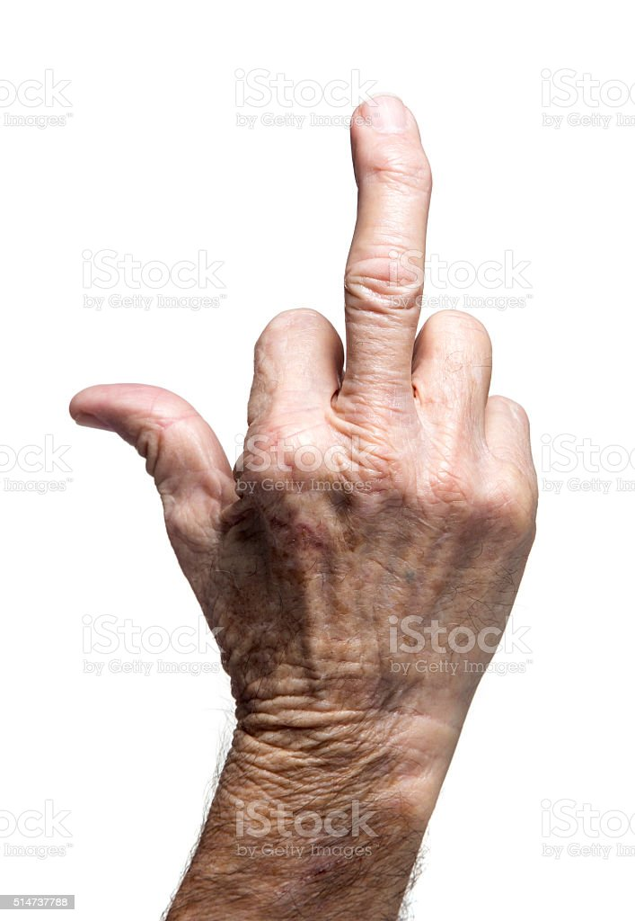 weathered senior hand showing the finger stock photo