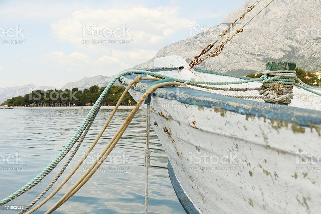 weathered ship with colourful mooring rope  bollard  Croatia royalty-free stock photo