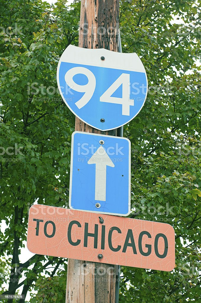 Weathered sign pointing to Interstate 94 in Milwaukee WI stock photo