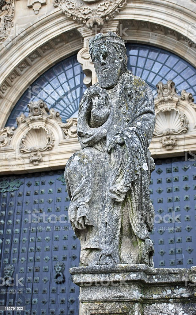 Weathered statue of Saint James at cathedral in Spain stock photo