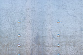 Weathered steel plate with buttons, copy space