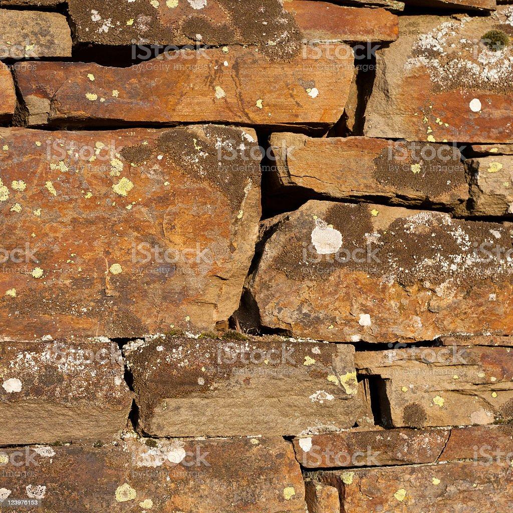 Weathered stone wall background royalty-free stock photo