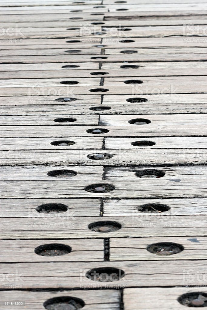 Weathered timber road sleepers with bolts royalty-free stock photo