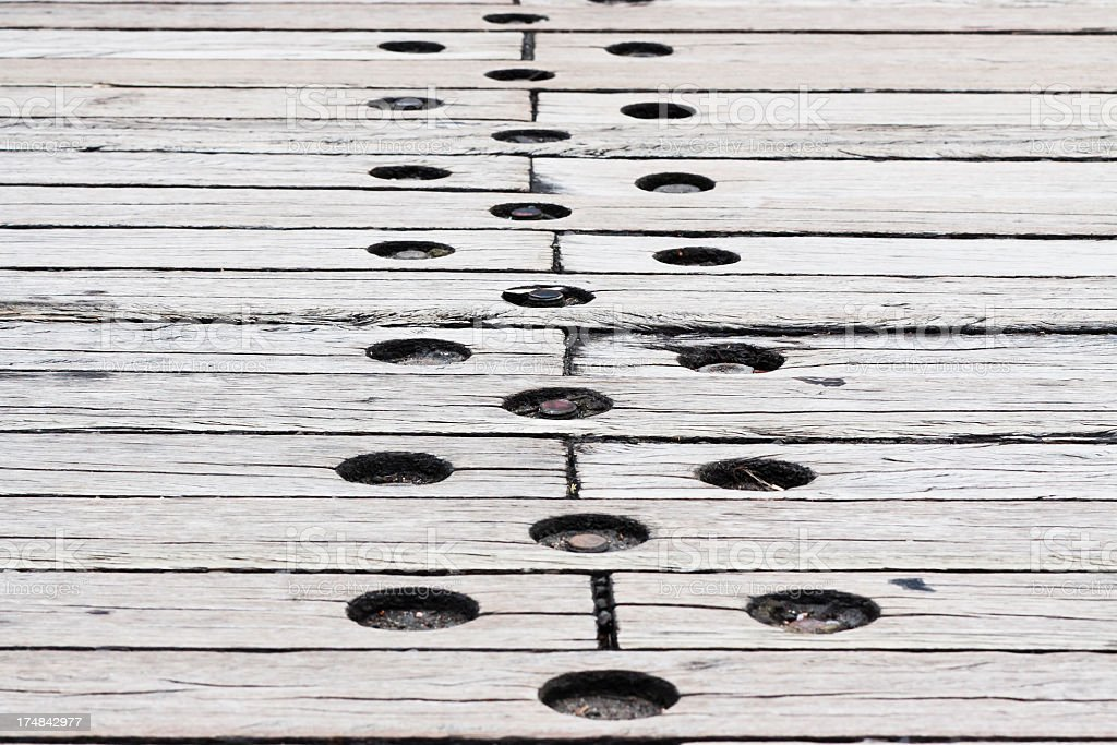 Weathered timber sleepers road with bolts,, copy space royalty-free stock photo