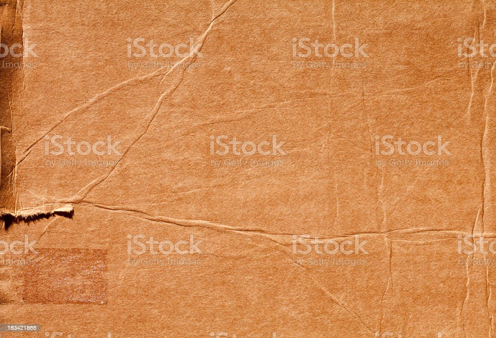 Weathered, Torn, Distressed piece of Grungy Cardboard. royalty-free stock photo