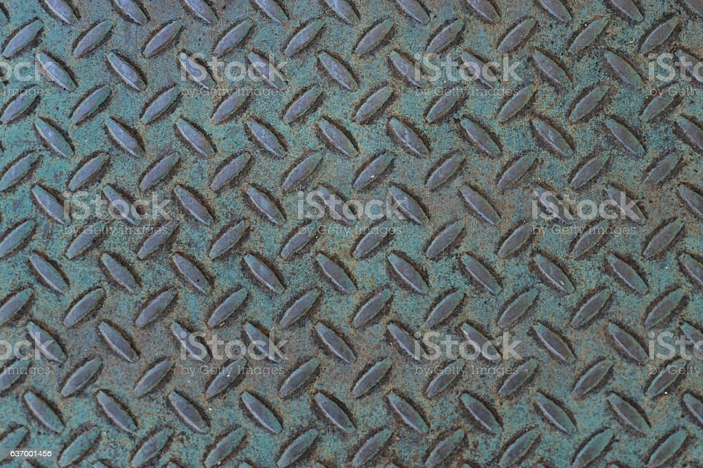 Weathered treadplate background with blue-green patina stock photo