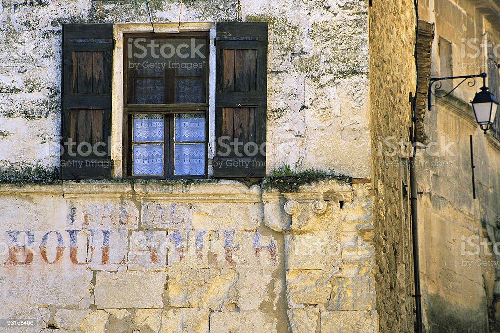 Weathered window and shutter stock photo
