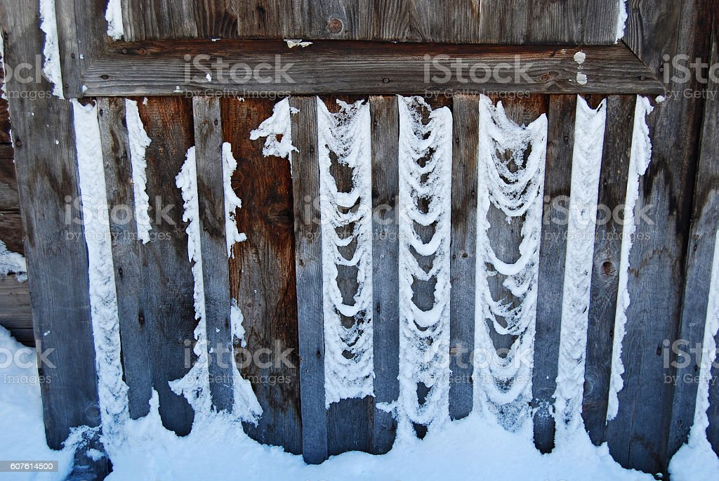 Weathered wood in winter stock photo