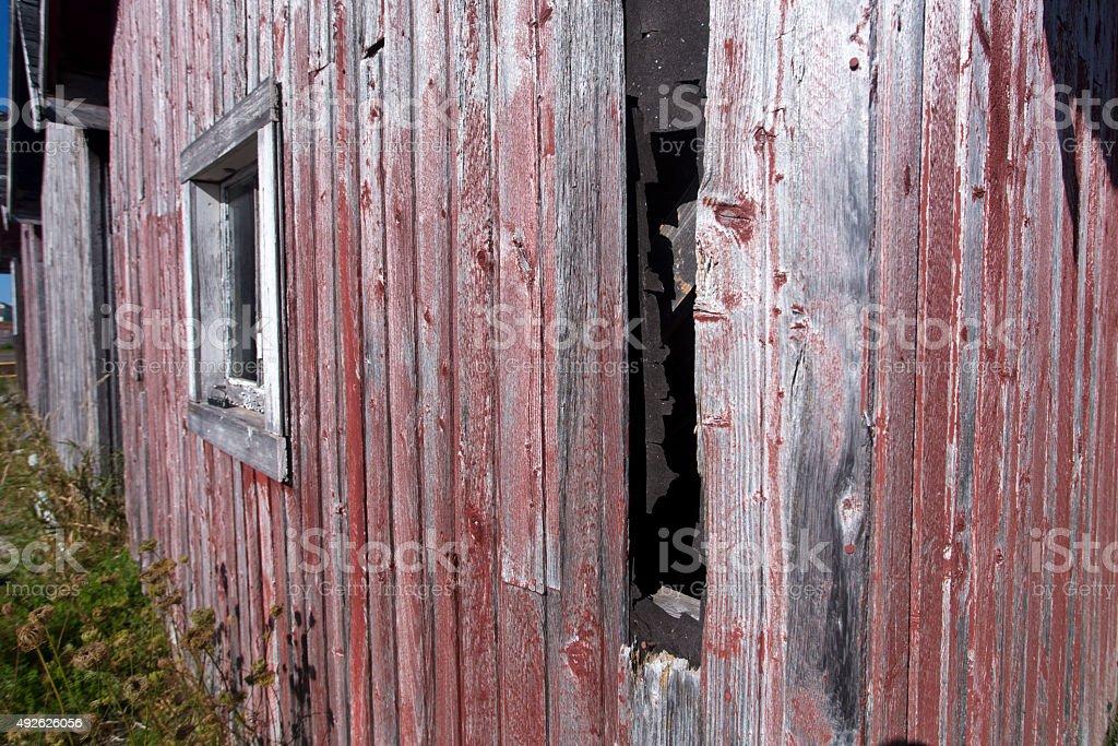 weathered wood siding on shed stock photo