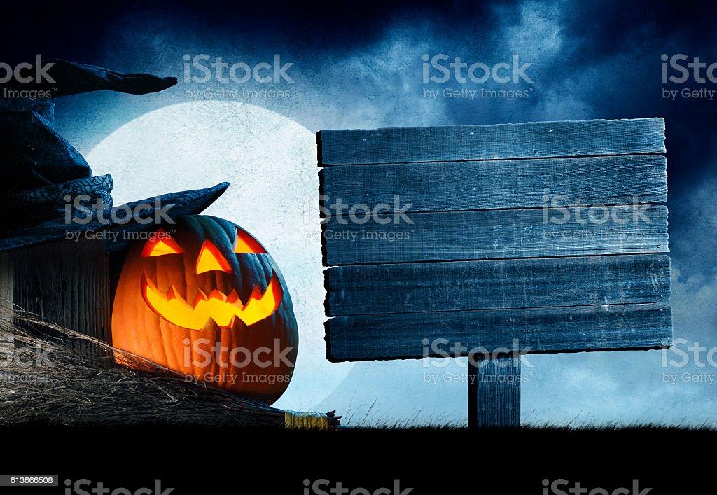 Weathered Wood Sign And Jack O Lantern stock photo