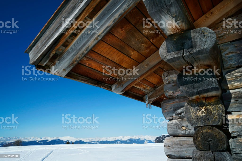 weathered wooden hut in scenic winter landscape on seiser alm stock photo