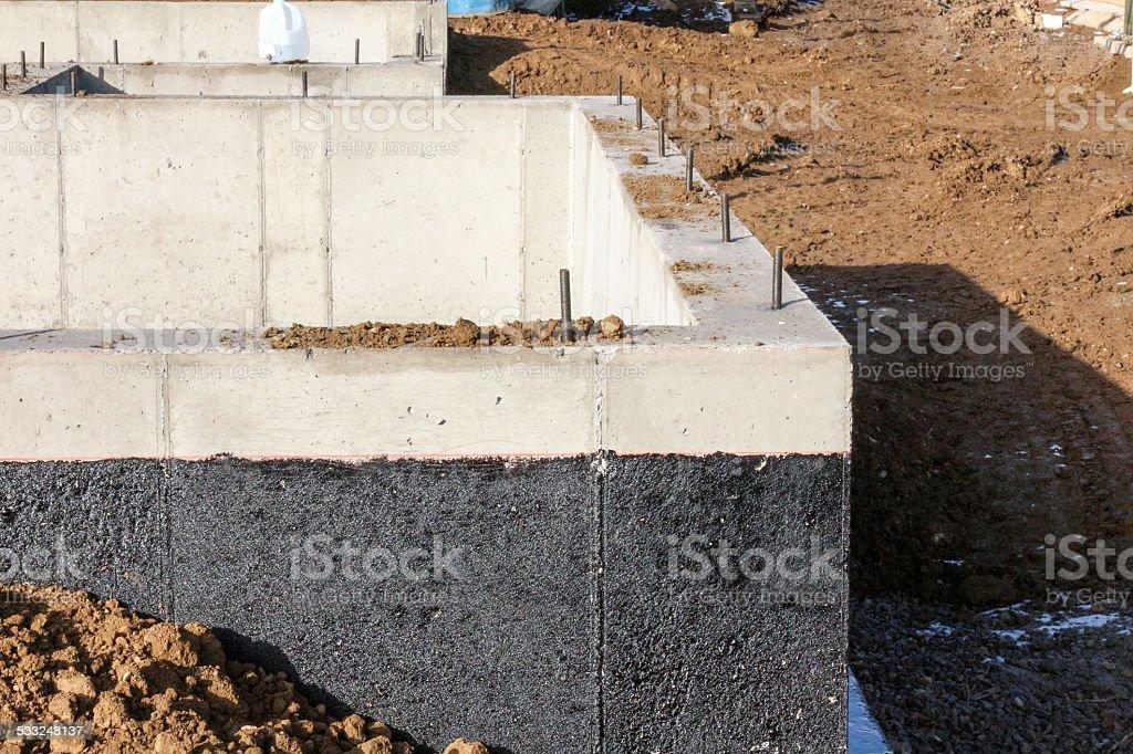 Weatherproofing sealant on a concrete foundation stock photo