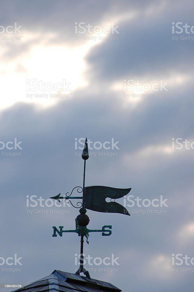 Weathervane on cloudy day stock photo