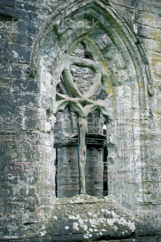 Weather-worn sandstone window in cathedral at Dunkeld Scotland stock photo