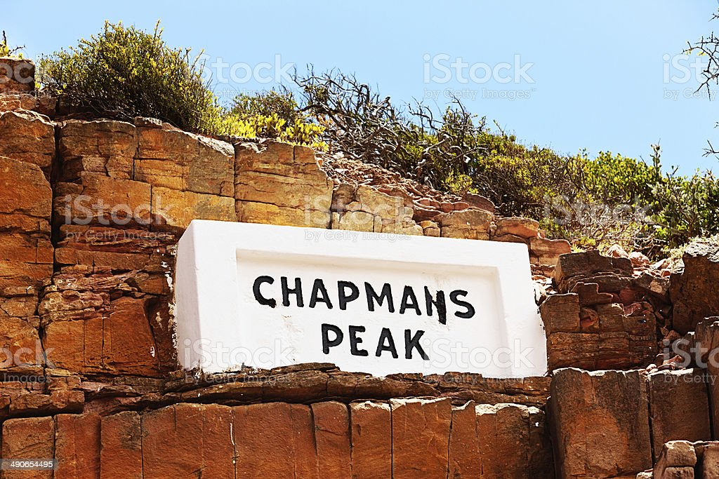 Weather-worn sign labelling Chapmans Peak in Cape Town stock photo