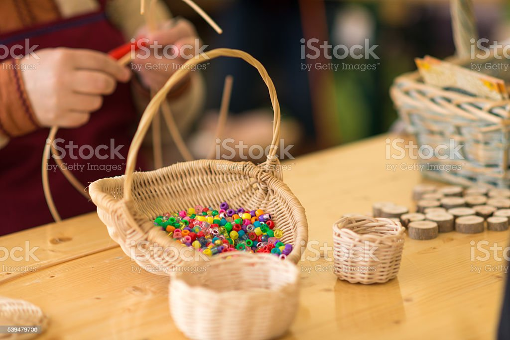 weave a basket - and colorful pearls for crafting -basketry stock photo