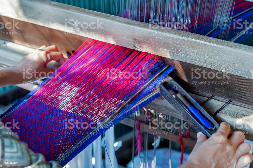 weaves with an old loom handcraft rug stock photo