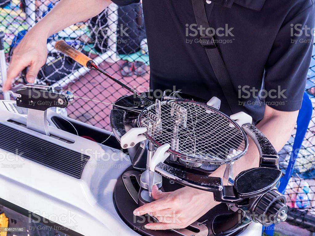 weaving, Stringing badminton racket on racquet weaving machine stock photo