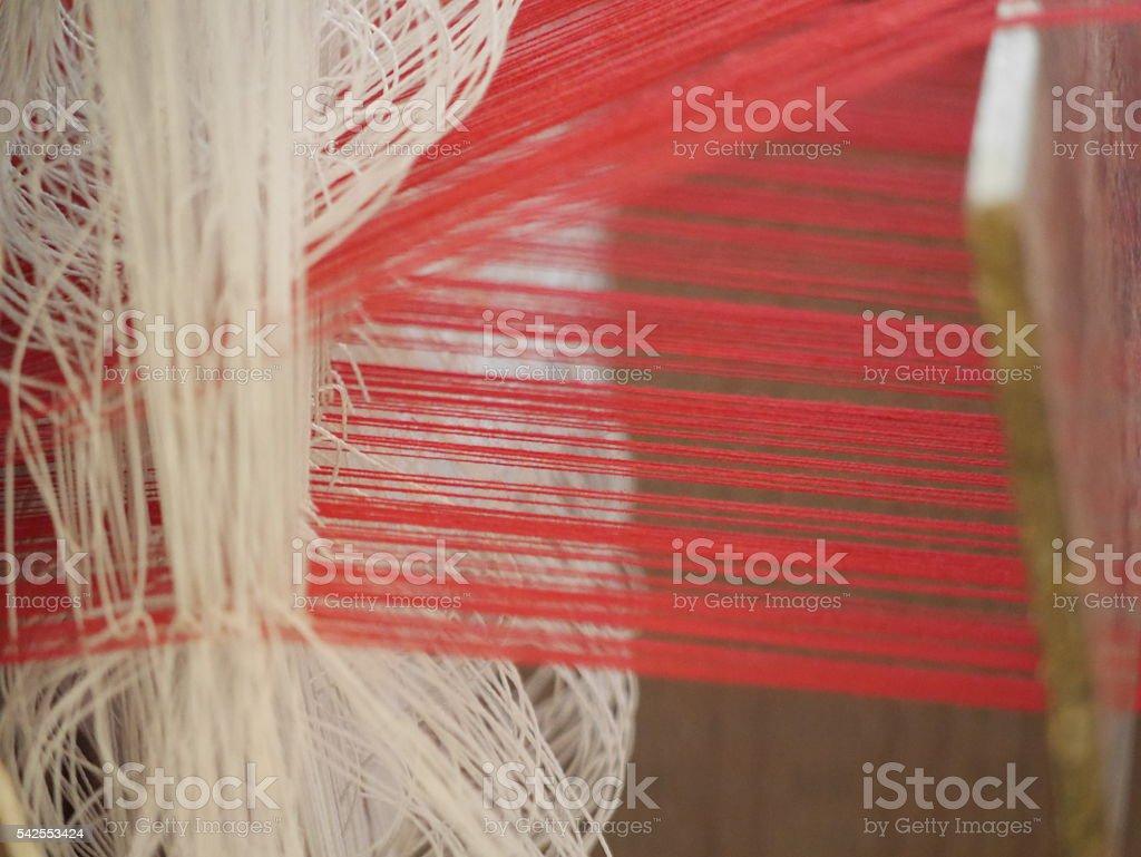 Weaving the cotton thread to cotton cloth stock photo