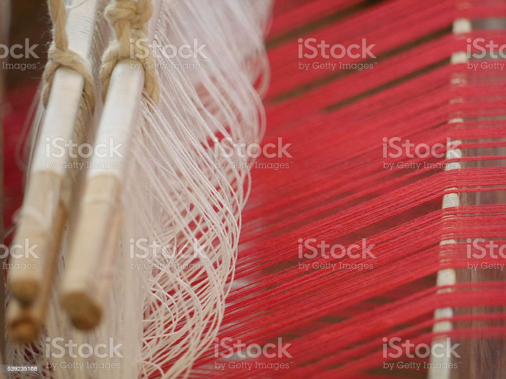 weaving thread to become the cotton fabric cloth stock photo