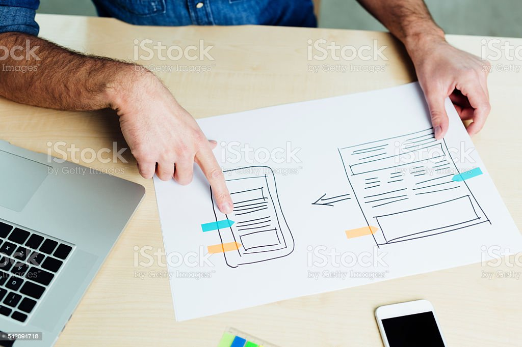 Web designer designing a responsive app stock photo