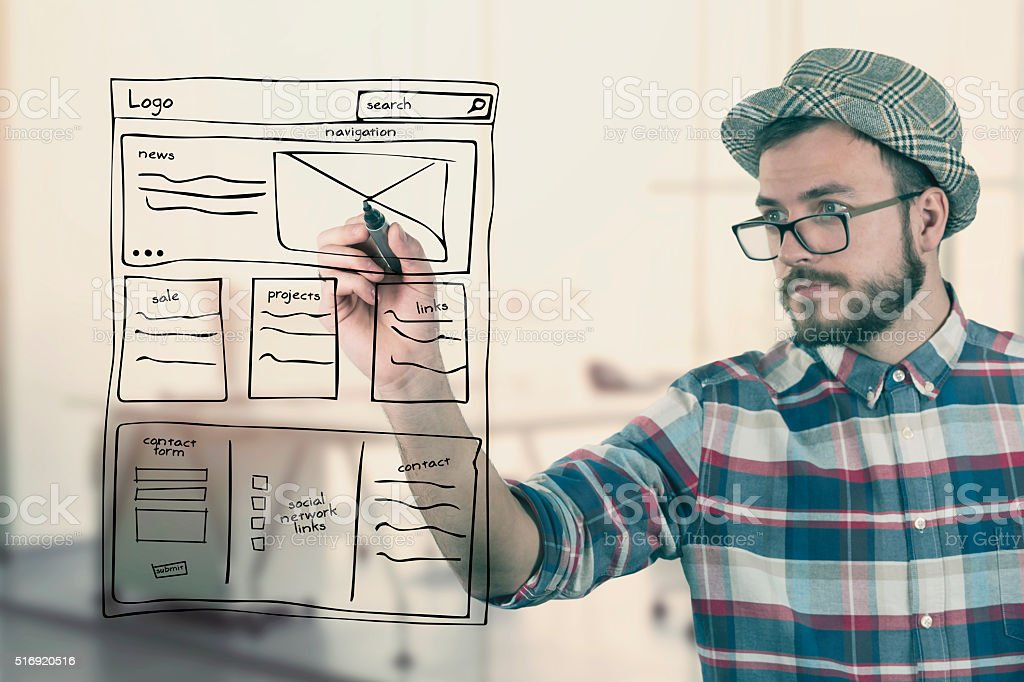 web designer drawing website development wireframe at office stock photo