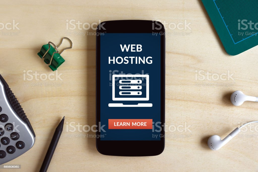 Web hosting concept on smart phone screen on wooden desk stock photo