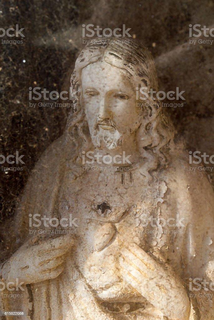 Web in sacred hearth Jesus medium shot stock photo