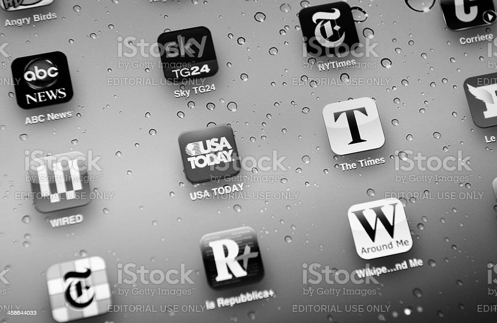 Web Newspaper editorial apps in a new Ipad 2 stock photo