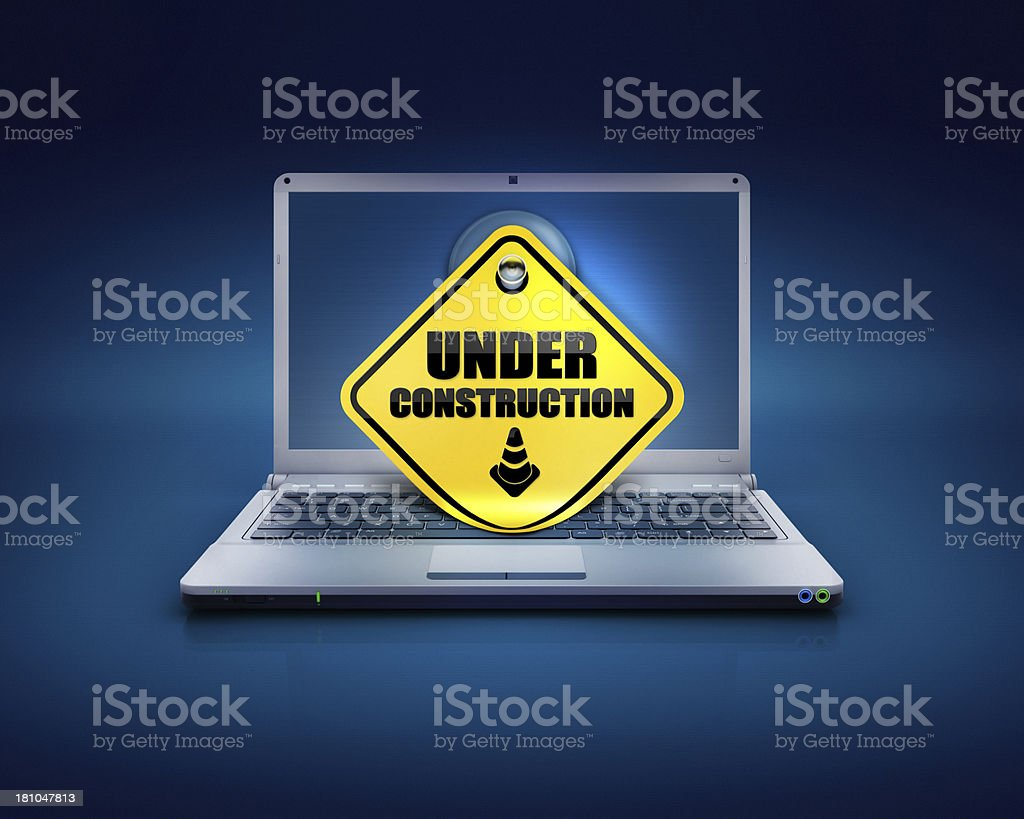 website under construction sign on computers pc stock photo