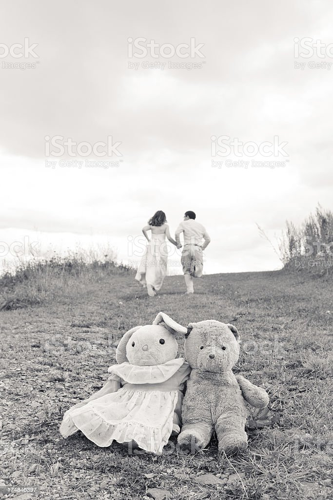 Wedded couple run into a future together royalty-free stock photo