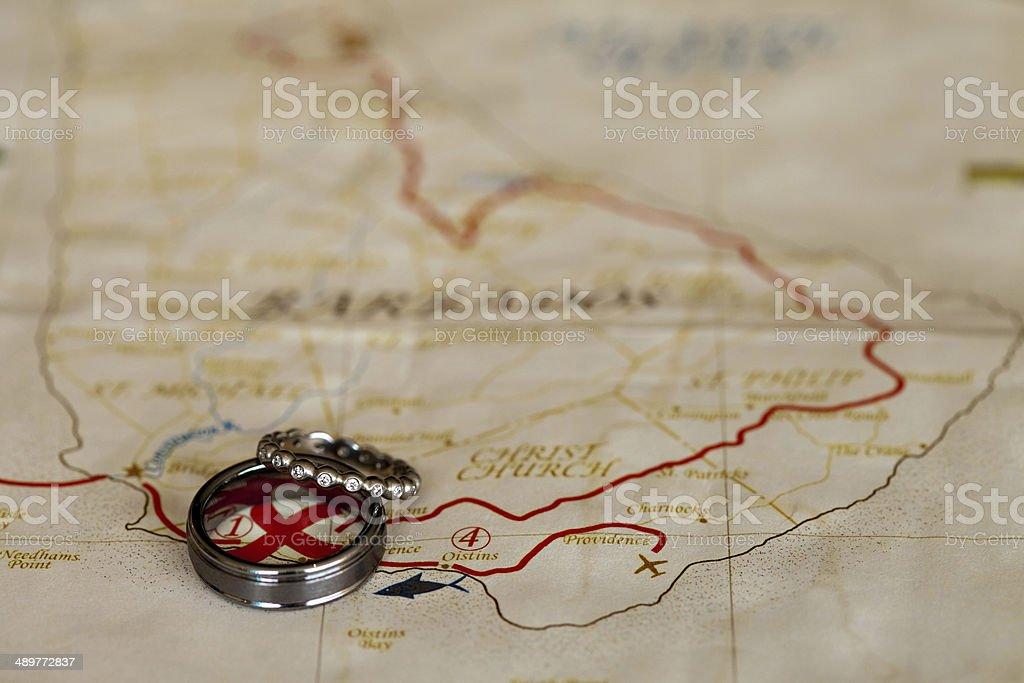 Wedding bands on map stock photo