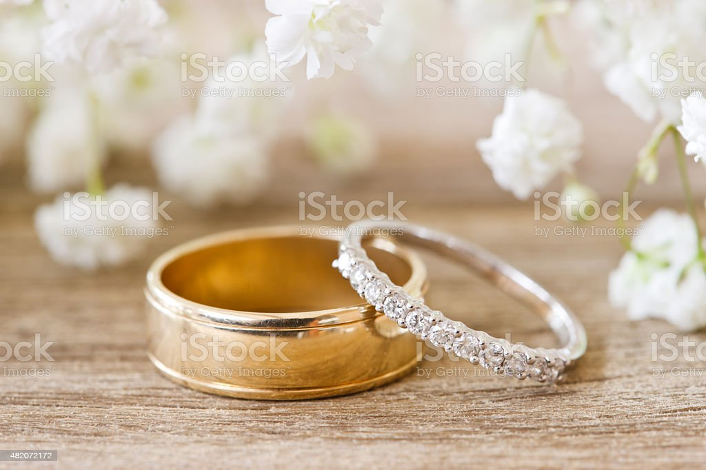 Wedding Bands on Rustic Timber Table stock photo