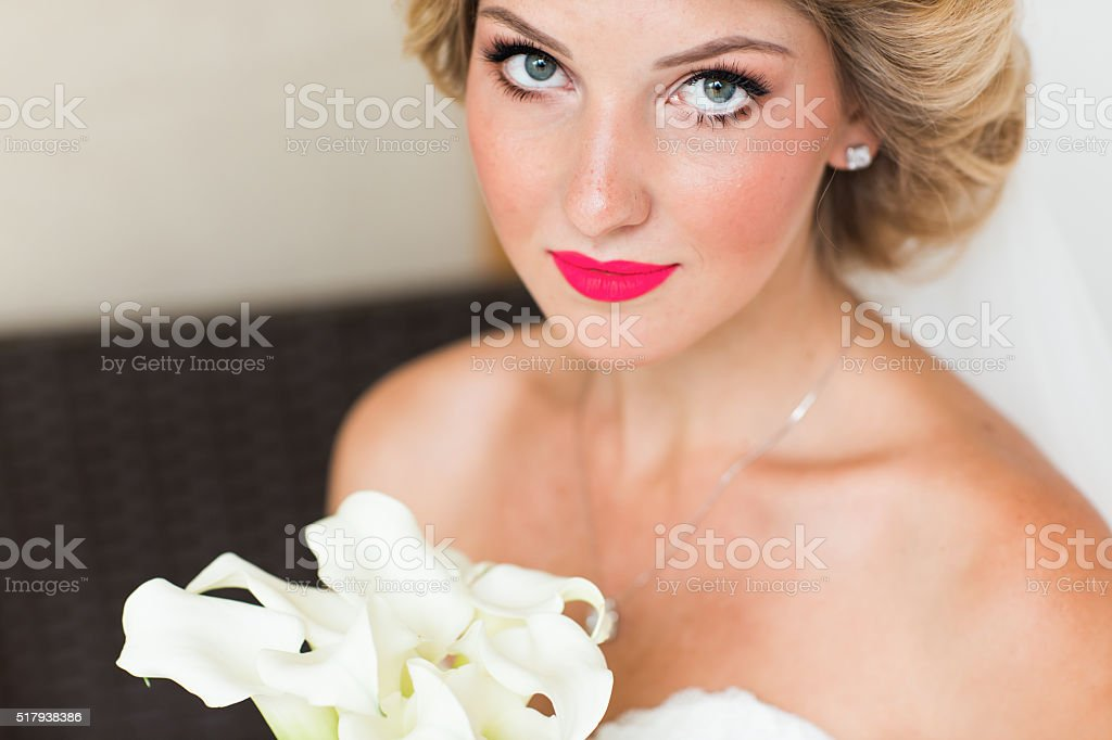 Wedding. Beautiful bride with bouquet, close-up stock photo