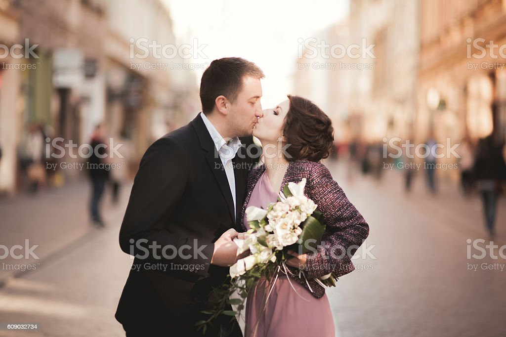Wedding. Beautiful couple, bride with pink dress walking in the stock photo