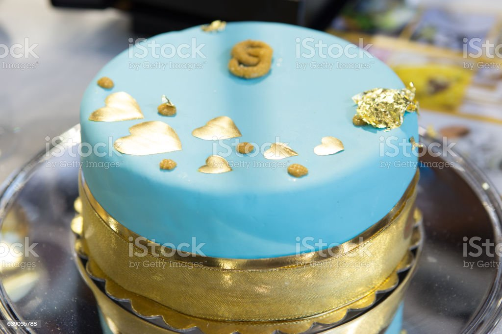Wedding blue cake  with edible gold leaf stock photo
