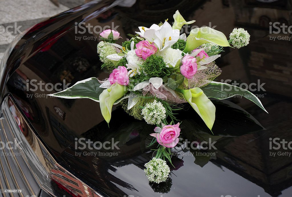 Wedding boquet on expensive car cowl royalty-free stock photo