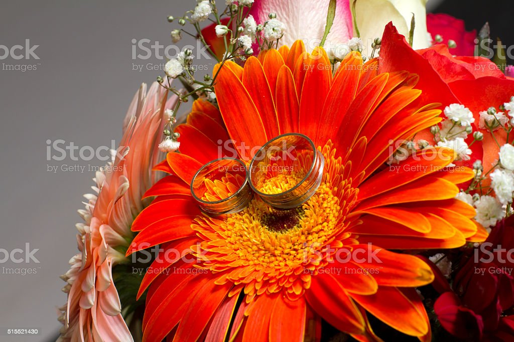 wedding bouquet and rings stock photo