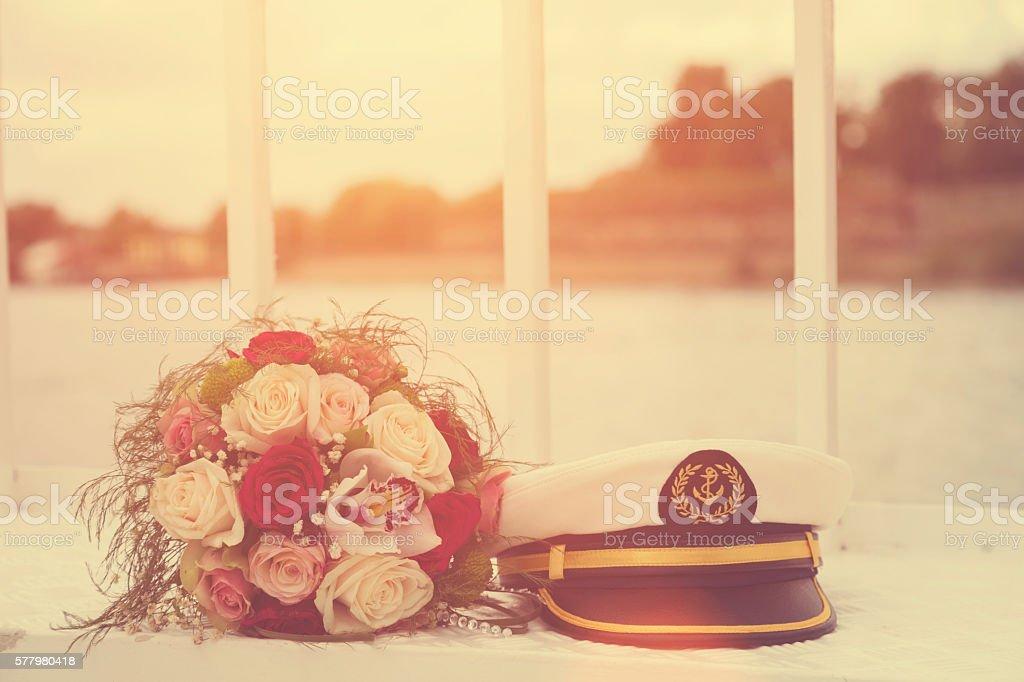 Wedding bouquet and sailor cap. stock photo